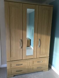 Triple door wardrobe with mirror & 4 drawers. In excellent condition from smoke free home
