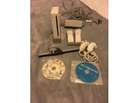 Nintendo Wii with 2 remotes, 2 nunchucks, 2 remote covers and 2 games