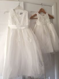 Stunning carriage and castles occasionwear- Girls dresses (worn once by 3 yr old and 8yr old)