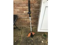 Worx battery lawn mower and strimmer