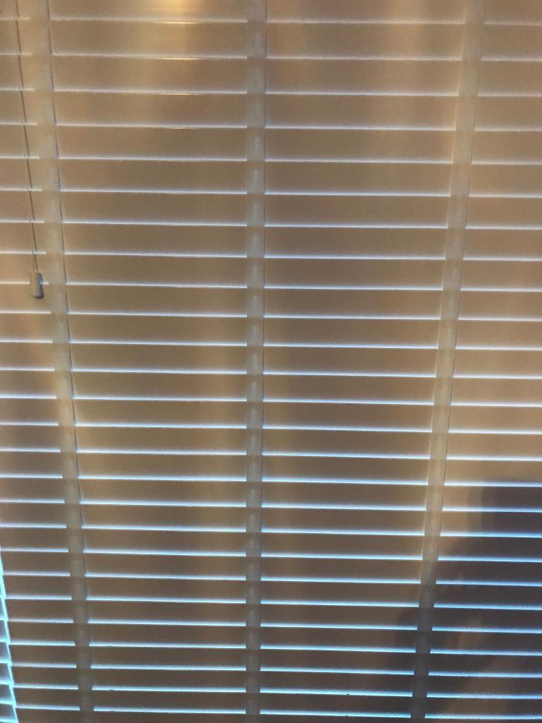 White ribbon patio blinds ideal for double patio