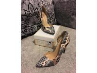 Stunning snake skin court heels