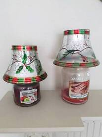 a pair of large glass candle shades