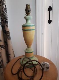 Yellow and green wooden urn style lamp without shade