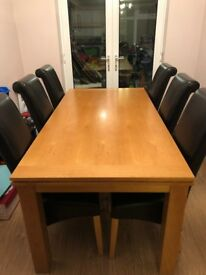 Dining table and chairs - solid wood oak table / brown leather chairs.