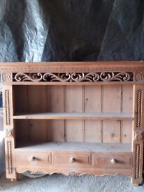 Pine carved wall shelves.