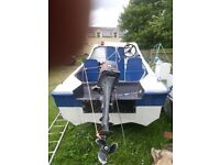 Great dory boat with 9.9 mercury engine