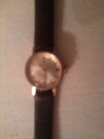 Tissot Ladies 9 ct Gold Watch.