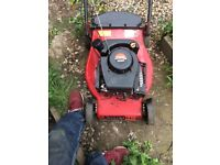 Mount field petrol mower with grass box runs well must collect £40.00