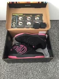 Girls heelys shoes/roller shoes