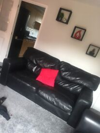 2 sofas black leather 2 seaters