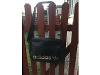 Small suitcase and adidas bag