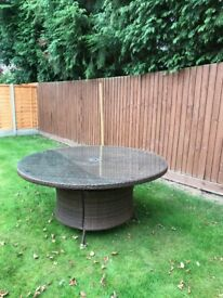 Brown Rattan oval table with glass top for up to 8 people