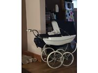 Child's silver cross pram excellent condition includes apron tray an bag covers pink an blue