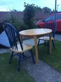 Extendable table and 2 chairs.