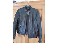 Ladjes leather motorcycle jacket size 16. Never worn. Has body armour in shoulders elbows and back.