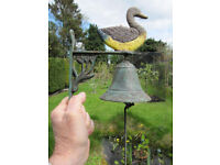 Bell, hand rung, ornamental with duck, cast iron, mounting frame
