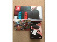 Nintendo Switch with accessory pack and 2 games