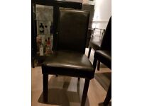 4 black padded dining room chairs - good condition