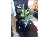 Green planter with vase ornament decor