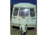 2 berth caravan in full working order. Dry. Full strong NR awning.
