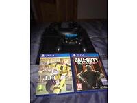 PS4 Console 2 games and a headset perfect condition