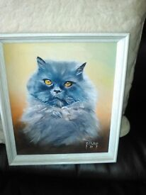 painting of a long haired cat framed and signed by artist.