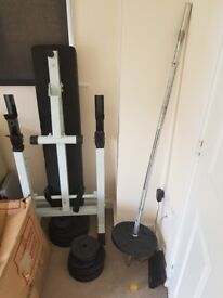 Folding Weight bench and iron weights and bars