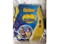Childs swim vest Floatie for ages 2-3 -15-18 kgs new in original pack