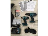 Brand new Makita cordless combi hammer drill and impact drill driver set with case!
