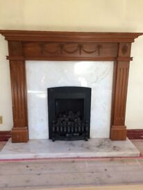 Living flame gas fire with surround and marble hearth