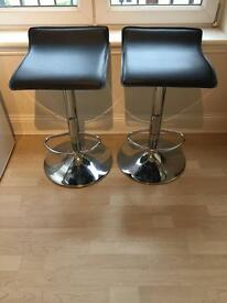 Two height adjustable stools