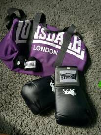Boxing gloves, wraps and bag
