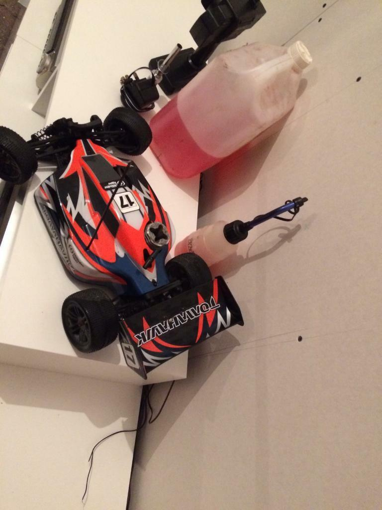 Nitro rc trx tomahawk sand buggyin Carmarthen, CarmarthenshireGumtree - Brilliant little car very fast few upstaged parts good condition just not used any more comes with new glow plug and charger refill bottle and spare fuel as shown in pics new remote control in box only taken out to programe it to the car is idling...