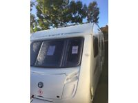 Swift charisma 550 2010 4 berth fixed bed with full awing