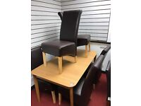 Extendable oak table and 6 Scrollback Heavy chairs in Chocolate leather