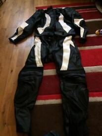 Men's black and white two piece motorbike leathers