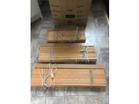 Wooden blinds in three different sizes