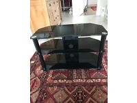 Black glass TV table with 2 shelves in excellent condition no marks or scratches.