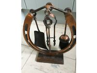 Retro fireside set, comprising horseshoe shaped stand and four fireplace tools.