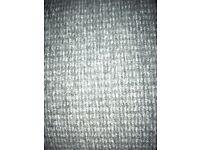 Scrap rolls of grey carpet