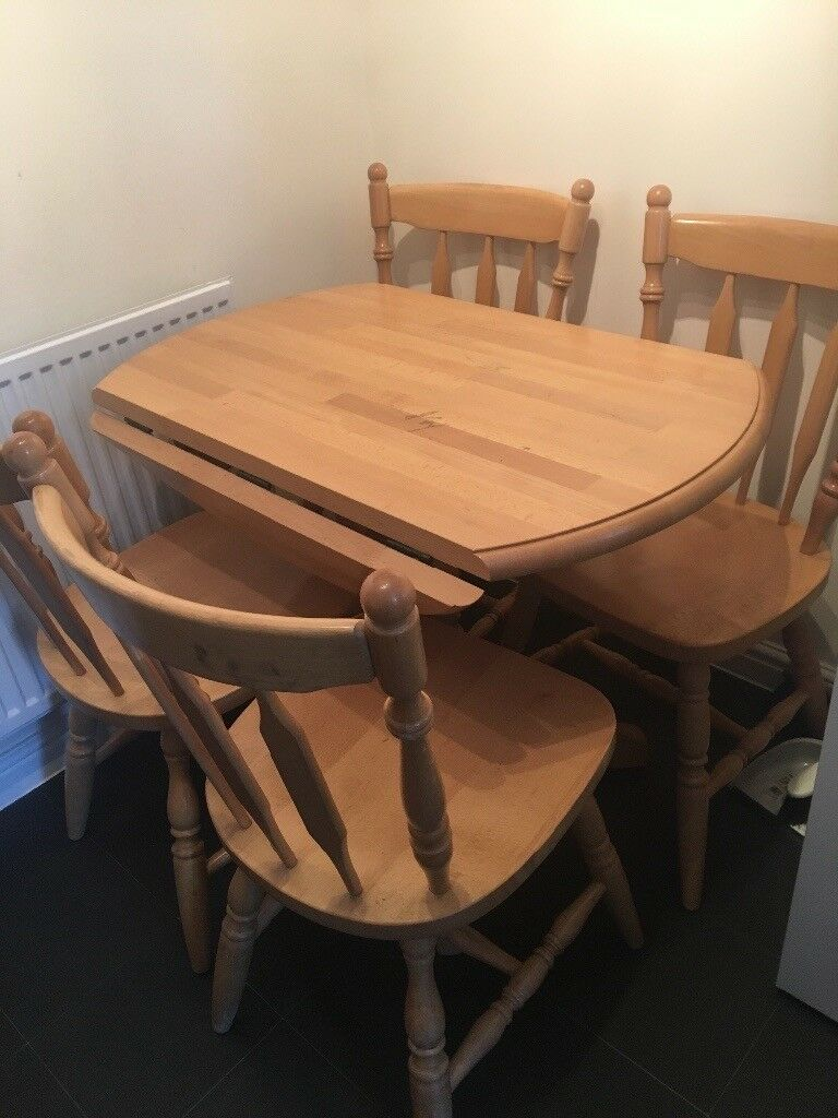 Wooden dining table and 4 chairs good condition | in ...