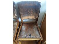 4 oak frame, leather upholstered dining chairs (ideal restoration project)