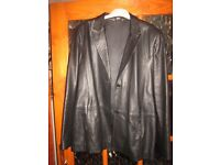 Lady's black leather jacket, as new. Size 16