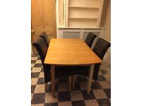 Extendable Wooden dining table & 4 faux leather chairs £120 ONO