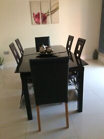DESIGNER GLASS DINNING TABLE WITH OPTION OF 4 OR 6 DINNING CHAIRS --- VERY NICELY LOOKED AFTER