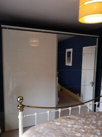 Large white and mirrored wardrobes