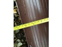 Brown plastic gutter and round & square pipe pieces