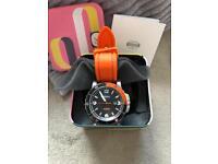 Men's orange and black fossil watch