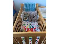 Cot for sale with mattress not including bedding
